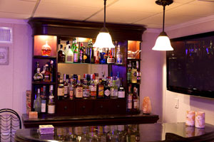 A basement bar installed in a finished basement in Brookline