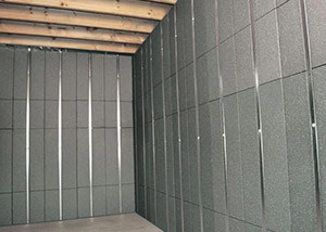 SilverGlo™ insulation and metal studs making up our Basement to Beautiful™ panels.  Installed in Newton.